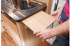 Aufklappbare Erweiterung der Küchenarbeitsfläche.